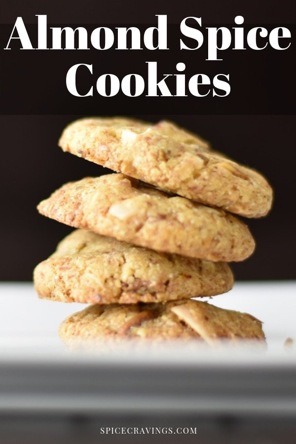 Made with whole wheat & almond flour, cardamom & nutmeg, these crumbly and crisp  Almond Spice Cookies, are just the perfect blend of sweet and spice. #spicecravings #indian #cookies #eggless #baking #almonds