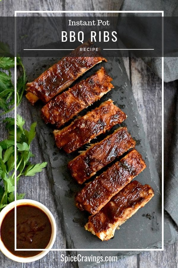 BBQ Pork Ribs served on a gray slate plate with bbq sauce