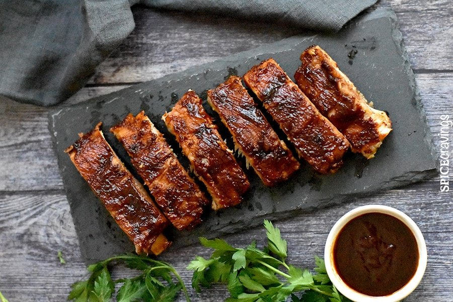 BBQ Pork Ribs served on a gray slate platter with bbq sauce