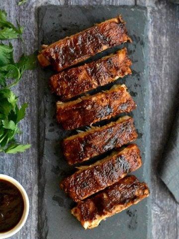 Crispy BBQ Ribs served on a slate platter
