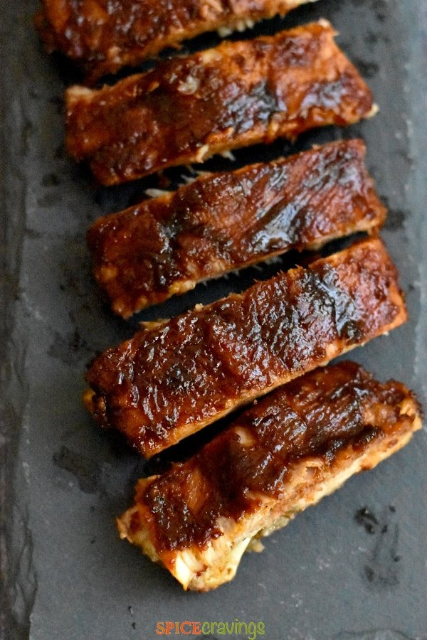 Crispy BBQ Ribs served on a slate platter