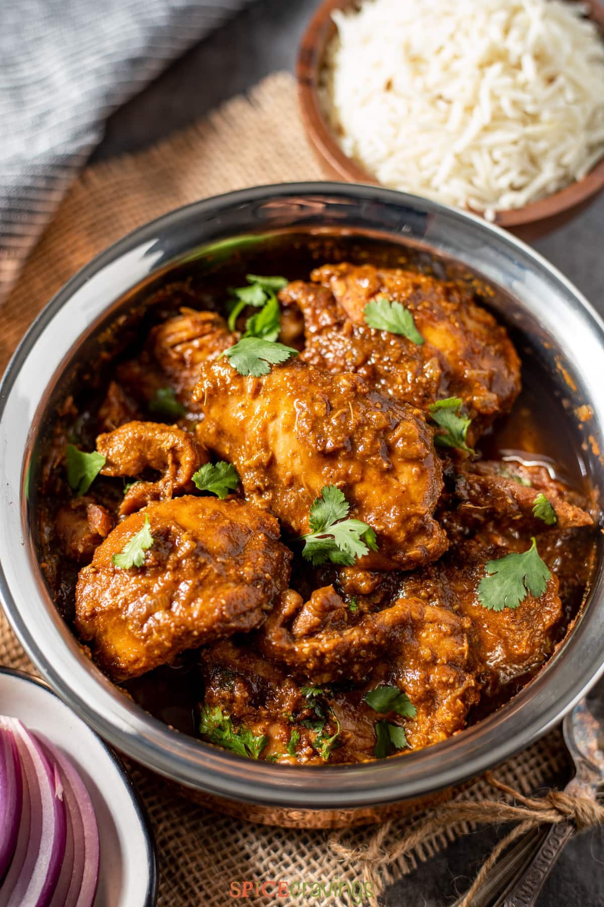 Chicken vindaloo curry served with cumin rice
