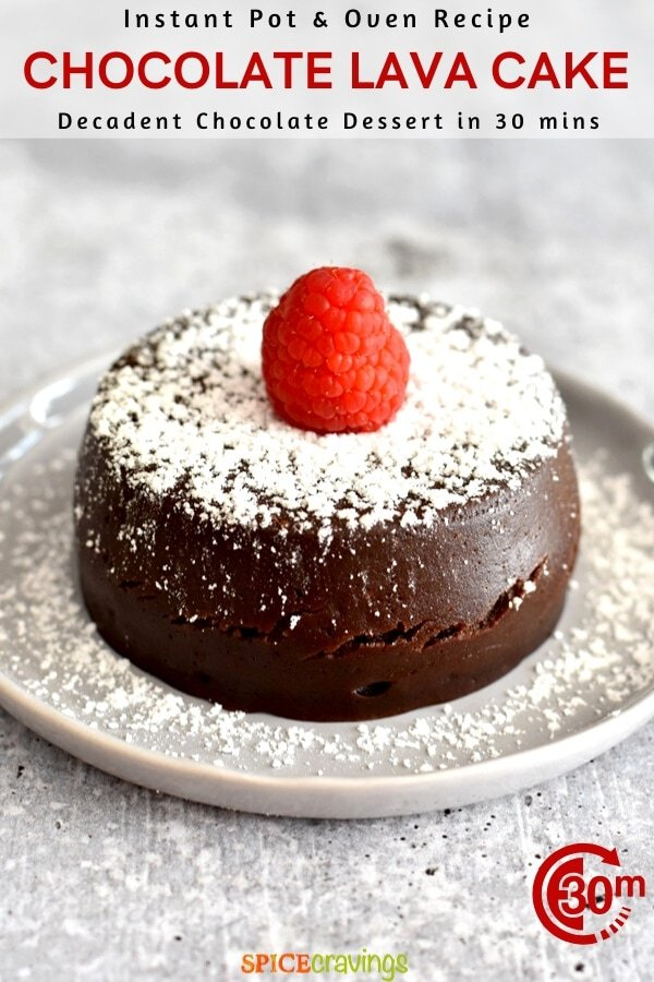 Chocolate lava cake topped with powder sugar and a raspberry