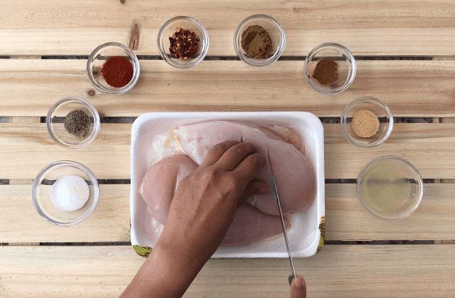 Making parallel cuts in chicken breast using a sharp knife