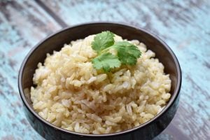 Instant Pot Brown Jasmine Rice served in a dark brown bowl