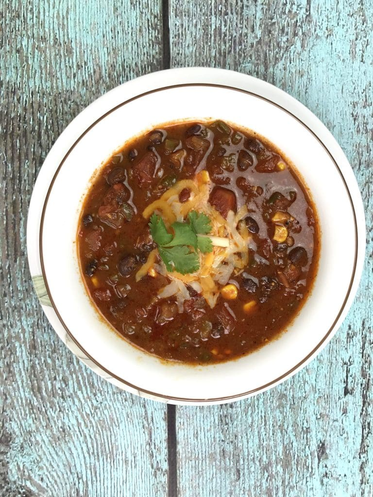 Weeknight Black bean chili in Instant Pot, pressure cooker chili, by Spice Cravings. This Weeknight Black Bean Chili in Instant Pot hascreamy black beans simmered in vegetable broth with sweet diced tomatoes, and fire roasted green chilies, and seasoned with taco seasoning and unsweetened cocoa powder! #food #foodie #foodblogger #delicious #recipe #instantpot #recipes #easyrecipe #cuisine #30minutemeal #instagood #foodphotography #tasty
