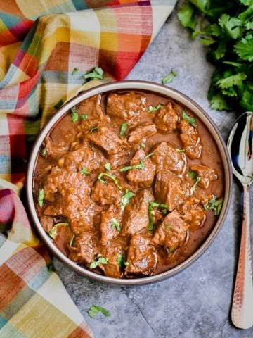 ethiopian beef stew recipe in brown bowl with spoon