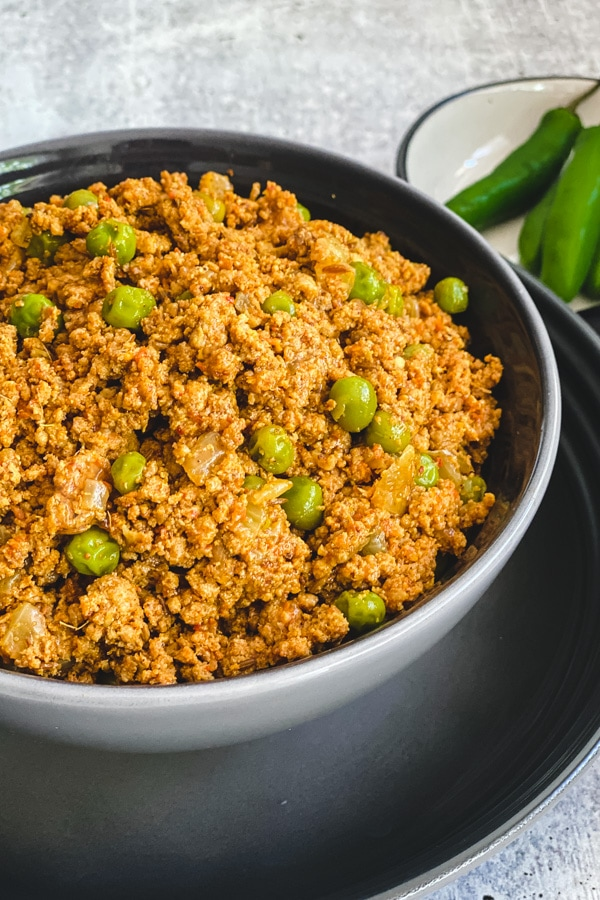 Minced meat simmered with Indian spices and green peas, by Spice Cravings. Keema Matar is an Indian dish where minced meat (Keema) is simmered with warm Indian spices (garam masala) and finished by sautéing with Green Peas (Matar). #food #foodie #foodblogger #delicious #recipe #instantpot #recipes #easyrecipe #cuisine #30minutemeal #instagood #foodphotography #tasty #indian