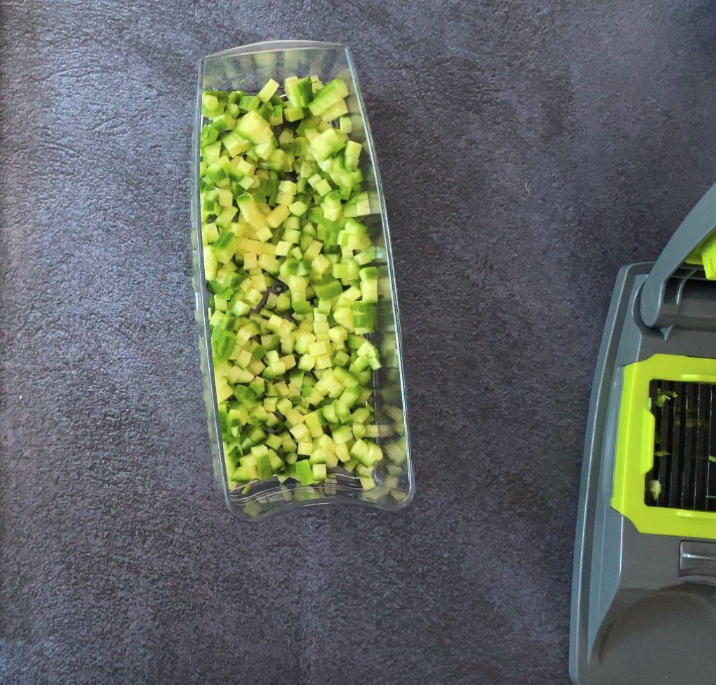 Finely chopped cucumber in a chopper dish