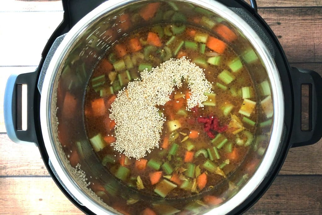 Water and quinoa added to the rest of the ingredients for Minestrone Soup in an Instant Pot