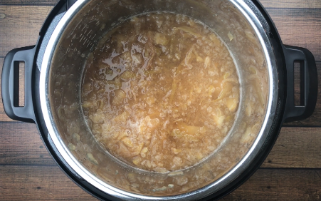 Cooked apples & spices in Instant Pot Spiced Apple Cider