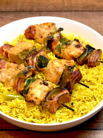 Chicken Skewers and Vegetables on Lemon Rice made in instant pot by Spice Cravings. Chicken and Vegetable skewers are a good combo of protein and vegetables. Chicken is cooked in an instant pot & served with a side of saffron rice. #food #foodie #foodblogger #delicious #recipe #instantpot #recipes #easyrecipe #cuisine #30minutemeal #instagood #foodphotography #tasty