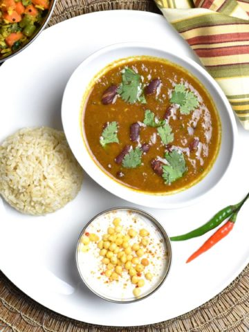 "Kidney Beans and Rice, Rajma Chawal, pot in pot, by Spice Cravings. Kidney Beans and Rice or Indian ""Rajma Chawal"" combines Creamy beans with warm Indian spices cooked in an instant pot, served with brown rice. #food #foodie #foodblogger #delicious #recipe #instantpot #recipes #easyrecipe #cuisine #30minutemeal #instagood #foodphotography #tasty"