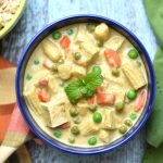Thai green curry with tofu garnished with mint leaves