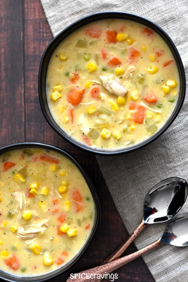 Two bowls of thick and chunky chicken corn chowder