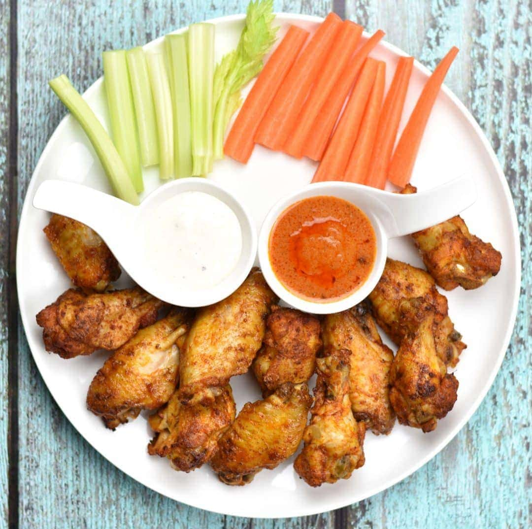 Instant pot Buffalo Chicken wings, Oven Baked wings by Spice Cravings. If you're hosting a game-day party or Superbowl, you need three things- good beer, a great TV, and Buffalo Chicken Wings!! These wings are spice rubbed, oven baked, or cooked in the Instant Pot,coated with spicy and delicious Buffalo sauce and grilled for a final tasty finish! #food #foodie #foodblogger #delicious #recipe #instantpot #recipes #easyrecipe #cuisine #30minutemeal #instagood #foodphotography #tasty
