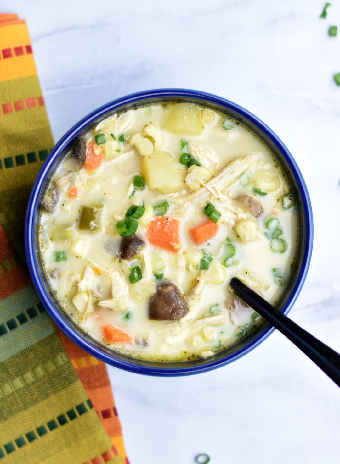 Gluten-Free Corn and Chicken Chowder in instant pot by Spice Cravings. Creamy, sweet, hearty and pure deliciousness in a bowl, that's how I would describe chowder. Enjoy in the summer or the winter by the fireplace on a cold winter night with a bowl of this Gluten-Free Corn & Chicken Chowder! This recipe reduces the carbs and goes gluten-free by removing the roux. #food #foodie #foodblogger #delicious #recipe #instantpot #recipes #easyrecipe #cuisine #30minutemeal #instagood #foodphotography #tasty