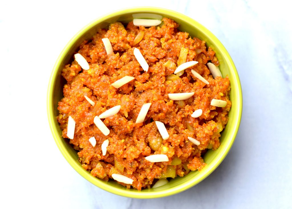 Instant Pot Carrot Halwa Gajar ka Halwa by Spice Cravings. Carrot Halwa or Gajar kahalwais adessert from Punjab, in the Indian subcontinent. It's consistency is between a fudge and a pudding. It is made by slow cooking gratedcarrotswith milk and sugar, flavored with cardamom and saffron andgarnished with chopped almonds and cashews. A perfect comfort dessert for winters. #food #foodie #foodblogger #delicious #recipe #instantpot #recipes #easyrecipe #cuisine #30minutemeal #instagood #foodphotography #tasty
