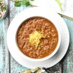 Instant Pot Chicken Chili, By Spice Cravings. This is a spicy, tasty, quick 'n' easy, and healthier chicken chili recipe. Made with ground chicken, taco seasoning and creamy pinto beans, you'll love this protein and fiber packed warm bowl of goodness, on a cold, winter night too. #food #foodie #foodblogger #delicious #recipe #instantpot #recipes #easyrecipe #cuisine #30minutemeal #instagood #foodphotography #tasty