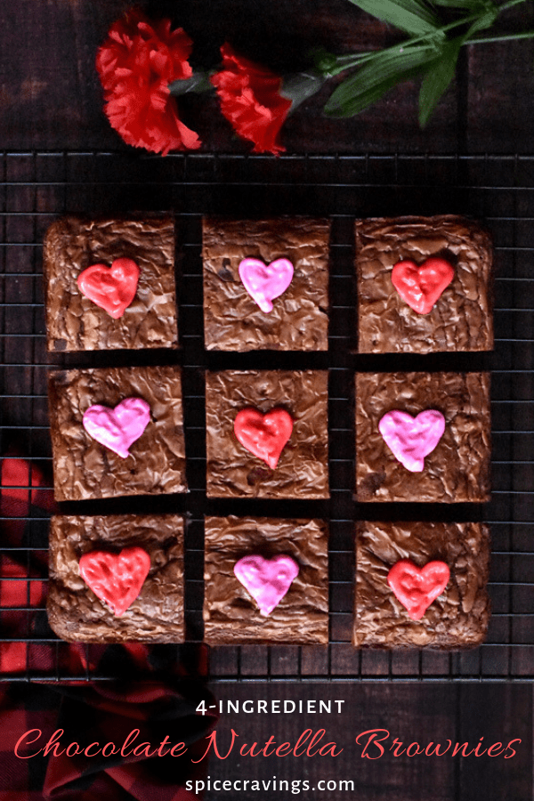 Chocolate brownies decorated with icing pink and red hearts