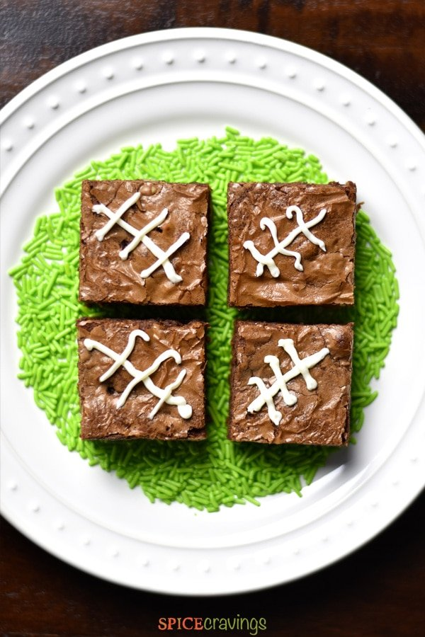 Chocolate brownies iced with a football symbol for super bowl