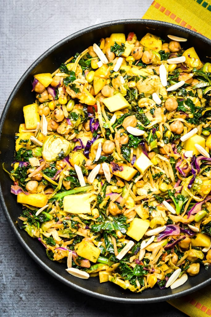 Kale Chickpea salad with mango in frying pan