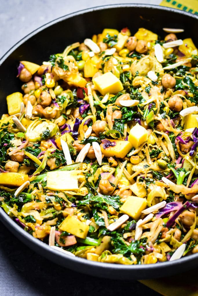 Kale, chickpeas and mango salad in skillet