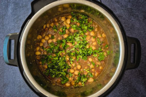 punjabi chole finished with chopped cilantro in instant pot