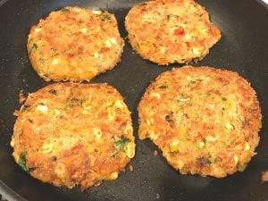veggie bean burger patties in the pan