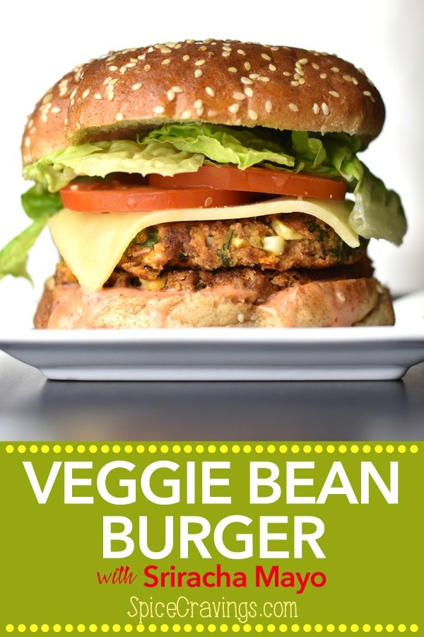A delicious veggie bean burger, with a golden brown bean-patty, sandwiched between two warm, butter-toasted buns, the fresh crunch of lettuce and tomato, a slice of spicy pepper-jack, smothered in a sweet and spicy Sriracha-mayo sauce. #spicecravings #burger #vegetarian #beans