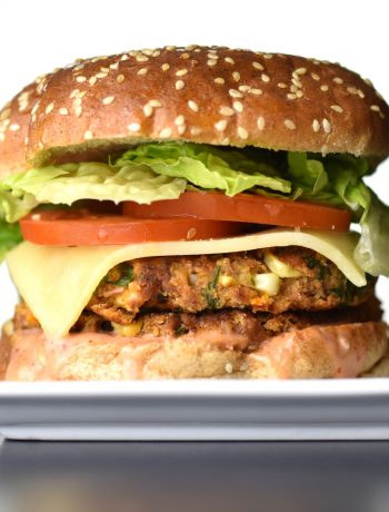 A delicious veggie bean burger, with a golden brown bean-patty, sandwiched between two warm, butter-toasted buns, the fresh crunch of lettuce and tomato, a slice of spicy pepper-jack, smothered in a sweet and spicy Sriracha-mayo sauce. by Spice Cravings. #cooking #food #recipe #recipes #foodphotography #foodblogger #yummy #delicious #foodie #instantpot