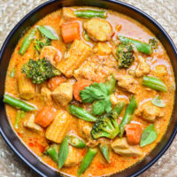 A bowl of thai Massaman Curry made with chicken and assorted vegetables