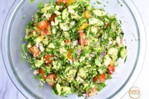 mixed quinoa tabbouleh salad in glass bowl