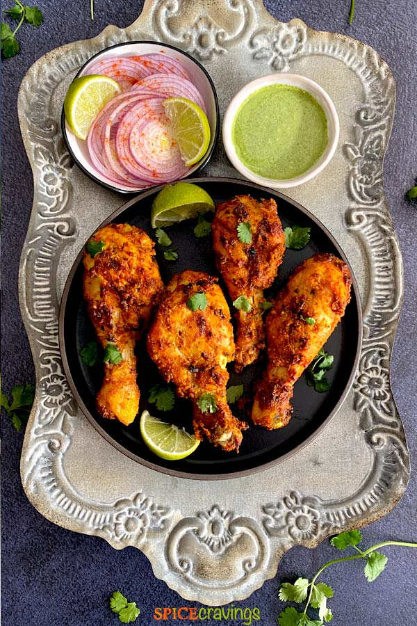 Tandoori Chicken Recipe, with chicken marinated in yogurt, lemon juice, aromatics and bold Indian spices. By Spice Cravings. #cooking #food #recipe #recipes #foodphotography #foodblogger #yummy #delicious #foodie