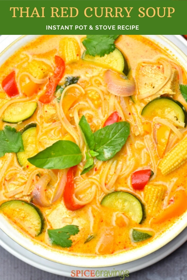 A bowl of thai red curry soup with vegetable and noodles