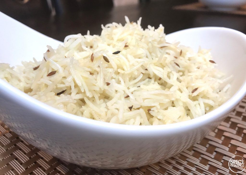 Fluffy basmati rice with cumin seeds served in a white bowl