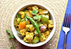 Soft and creamy paneer sauted with onions, peppers and chilies, this is the recipe for Kadai paneer