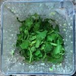 Fresh Cilantro leaves added to the blender for cilantro chutney
