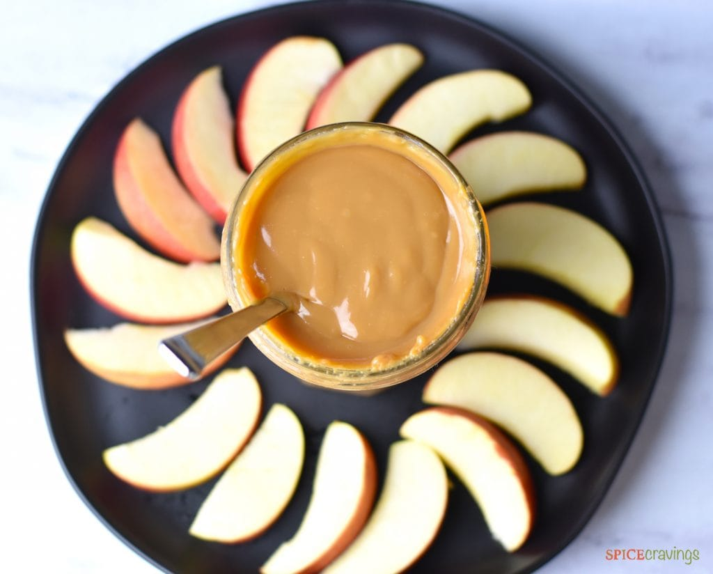 Homemade Instant Pot Dulce De Leche served with apple slices