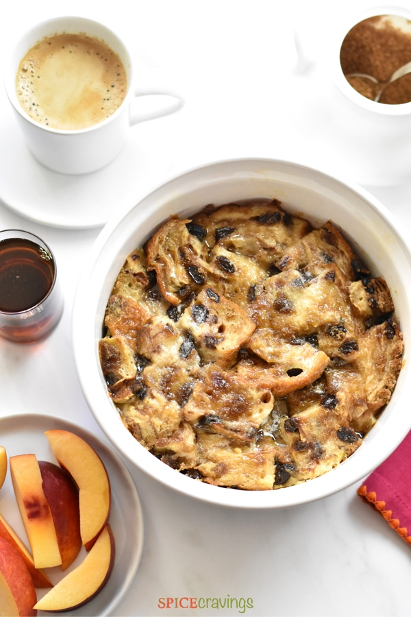Cinnamon Raisin French Toast casserole served with coffee and fruit on the side