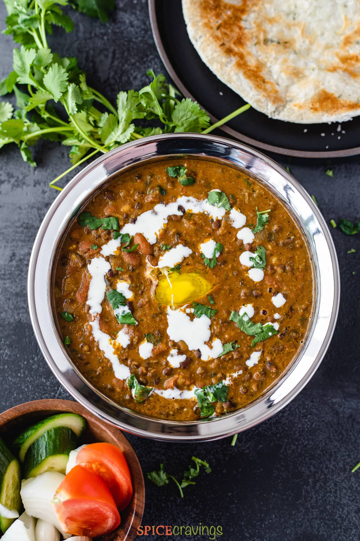 Instant pot dal makhani served with naan and rice