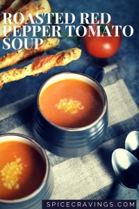 Roasted red pepper soup garnished with grated parmesan cheese