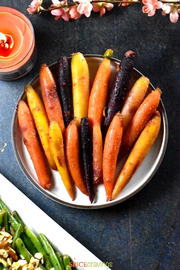 Honey or Maple glazed carrots served on a white clay plate