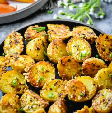 Parmesan roasted potatoes served with glazed carrots