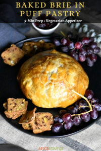 Golden Crispy Baked Brie with grapes and crackers on the side