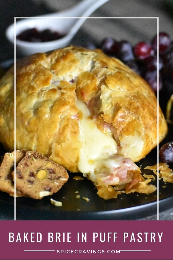 Creamy brie coated in cranberry sauce, wrapped in puff pastry & baked till its golden brown, this Baked Brie is one of the easiest and tastiest appetizers. #spicecravings #appetizers #baked #brie #puffpastry #vegetarian #easyrecipes