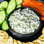 Spinach artichoke dip served in a black bowl