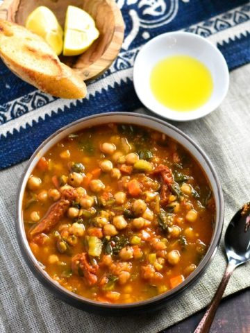 Moroccan Chickpea Soup served with olive oil and toasted baguette