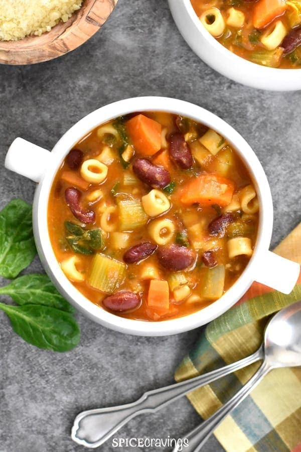 A big bowl of Pasta fagioli Soup with red beans, pasta, celery and carrots