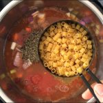 Adding pasta to the Instant Pot to make Pasta Fagioli